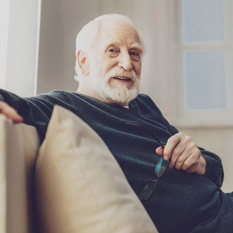 Elderly man on couch